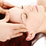 woman getting a head and shoulder massage
